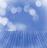Empty wooden deck table with blue soft focus background. Ready for product display montage. Royalty Free Stock Photos