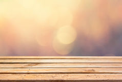 Empty wooden deck table on bokeh background Royalty Free Stock Photos