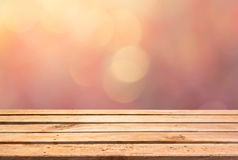 Empty wooden deck table on bokeh background Royalty Free Stock Images