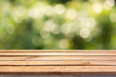Empty wooden deck table on bokeh background Stock Photography