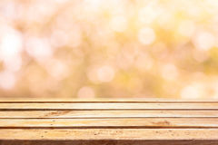 Empty wooden deck table on bokeh background Stock Photo