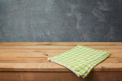 Empty wooden deck table with checked tablecloth over blackboard background stock images