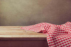 Empty wooden deck table with checked tablecloth for product montage display Royalty Free Stock Photography