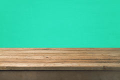 Empty wooden deck table over green wall background for product montage Royalty Free Stock Photo