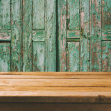 Empty wooden deck table over old wooden background Royalty Free Stock Photo