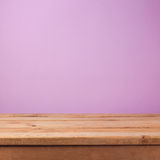 Empty wooden deck table over purple violet wallpaper. Easter spring background Royalty Free Stock Photo