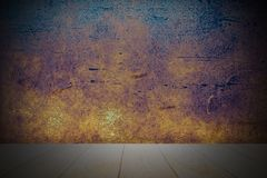 Empty wooden deck table over rust dark terracotta plaster wall for present product royalty free stock image