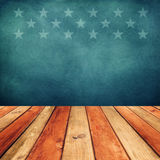 Empty wooden deck table over USA flag background. Independence day, 4th of July background. Royalty Free Stock Image
