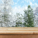 Empty wooden deck table over winter nature background. For product montage display stock photography
