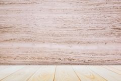 Empty wooden deck table over wood wallpaper background for present product. Empty wooden deck table over wood wallpaper in background for present product stock photos
