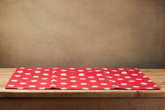 Empty wooden deck table with polka dots tablecloth Stock Photography
