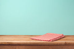 Empty wooden deck table and red checked tablecloth Stock Images