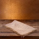Empty wooden deck table with tablecloth. Free space for your text Stock Photos