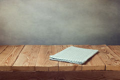 Empty wooden deck table with tablecloth over grunge background. Perfect for product montage display. Empty wooden deck table with tablecloth over grunge stock image