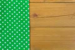 Empty wooden deck table with tablecloth with polka dots Royalty Free Stock Photo