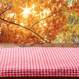 Empty wooden deck table with tablecloth. For product montage. Autumn landscape. Free space for your text Royalty Free Stock Photography