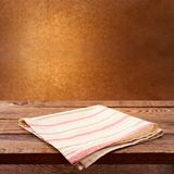 Empty wooden deck table with tablecloth Stock Photos