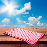 Empty wooden deck table with tablecloth Royalty Free Stock Photos