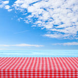 Empty wooden deck table with tablecloth for product montage texture background wallpaper. Royalty Free Stock Images