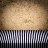 Empty wooden deck table with tablecloth for product montage. Stock Photography