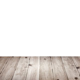 Empty wooden deck table with tablecloth for product montage. Royalty Free Stock Photography