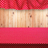 Empty wooden deck table with tablecloth for product montage. Stock Images