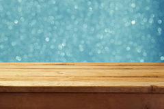 Empty wooden deck table with winter bokeh background. Ready for product display montage. Royalty Free Stock Images