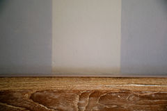 Empty wooden desk over white and blue cement wall background in vintage filter (for product display) stock photo