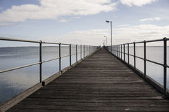 Empty Wooden Dock by Calm Sea during Daytime Royalty Free Stock Images