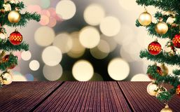 Empty wooden floor and christmas tree with bokeh effect on background stock photos