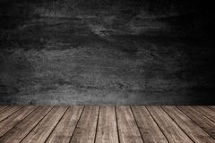 Empty wooden floor with dark concrete wall background, For produ Royalty Free Stock Photography
