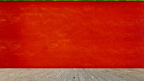 Empty wooden floor over red cement wall background, product disp Royalty Free Stock Photos