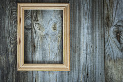 Empty wooden frame on aged gray wooden wall Stock Photos