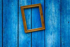Empty wooden frame on the blue wall Stock Photos