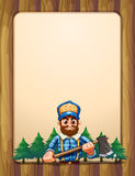 An empty wooden frame border with a lumberjack in front of the p Royalty Free Stock Image