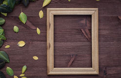 Empty wooden frame on brown wood surface Royalty Free Stock Image