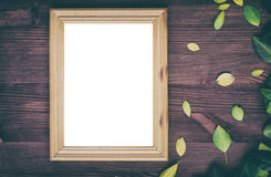 Empty wooden frame on brown wood surface Stock Photography