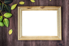 Empty wooden frame on brown wooden surface Royalty Free Stock Image