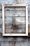 Empty wooden frame on a grunge background Stock Photography