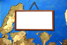 Empty wooden frame hanged in an old wall Royalty Free Stock Photos