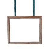 Empty wooden frame hanging on a rope on white background Stock Photography