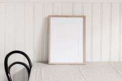 Free Empty Wooden Frame Mockup On Beige Linen Tablecloth Background. White Beadboard Wainscot Wall Paneling Background Stock Image - 175802801
