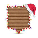 Empty wooden frame with santa claus hat Royalty Free Stock Photography