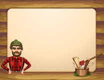 An empty wooden frame template with a lumberjack Royalty Free Stock Photos