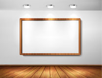 Empty wooden frame on a wall with spotlights Royalty Free Stock Photo
