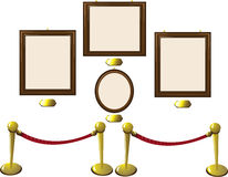 Empty Wooden Frames in a Museum. A vector cartoon representing some empty frames in a museum with blank golden tags. Every object is singly grouped Stock Photos