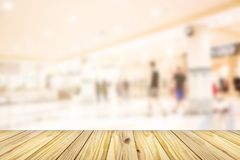 Empty wooden front of abstract blur many people shopping in department store, urban lifestyle concept stock photos