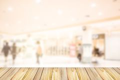 Empty wooden front of abstract blur many people shopping in department store, urban lifestyle concept stock image