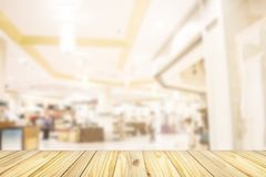 Empty wooden front of abstract blur many people shopping in department store, urban lifestyle concept stock images