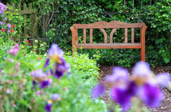 Empty wooden garden bench Stock Photo
